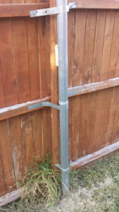 Secure old fence without removing the old rotted below ground post